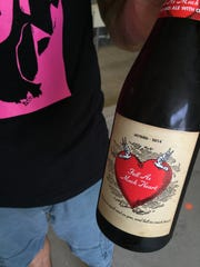 Josh Chapman displays the label of a bottle of Full