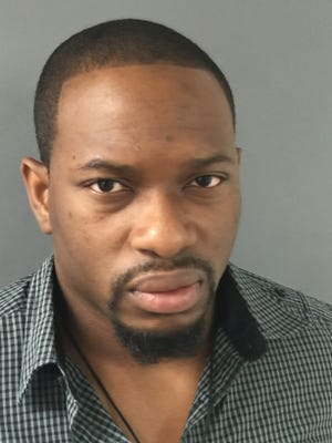 Ayoola Abudu, from Bronx, New York, arrested for allegedly stealing more than 100 pre-paid debit cards.