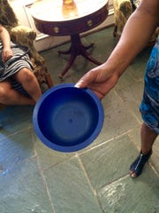 Mitchell holds the now-clean bowl in which she perceived a pair of faces.