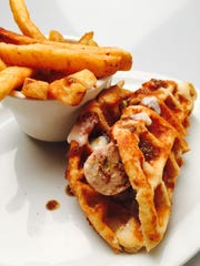 In celebration of National Hot Dog Month, Morris Tap & Grill is serving a selection of creative hot dogs. Pictured is the chicken and waffle dog.