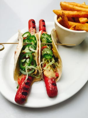 In celebration of National Hot Dog Month, Morris Tap & Grill is serving the taco dog.