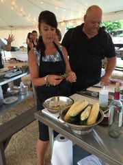 Robin Iaione and her husband, Kevin, of Mansfield, prepare ingredients at Harvest, Cook and Dine pilot event at Donaldson's Farm in Hackettstown on July 13, 2016.