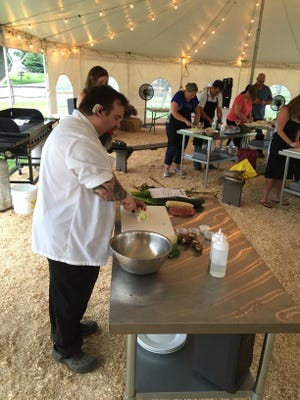 Chef Eric LeVine prepares a meal a Harvest, Cook and Dine pilot event at Donaldson's Farm in Hackettstown on July 13, 2016.
