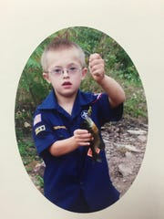 A photo of Zachary Adams, 19, of Kendall as a Cub Scout. Adams recently received his Eagle Scout award – the highest achievement a Boy Scout can earn.