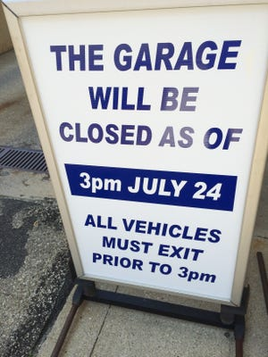 A sign posted outside the Fourth and Race garage shown Thursday, July 21, 2016.