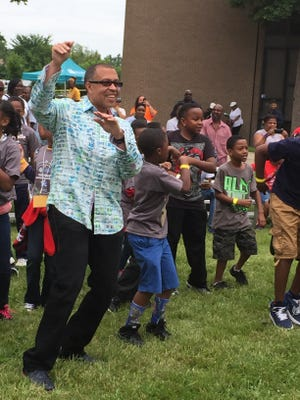 DPD Chief James Craig dances with children at the 2015 Summer Youth Jam event.