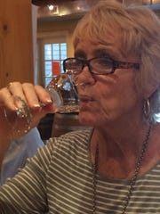 Mary Ellen Craig sips her sample of Bordeleau Winery's Moscato wine. The winery offers a selection of both dry and sweet wines to suit a variety of tastes.