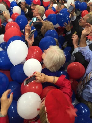 State Sen. Mae Beavers is buried by balloons after Donald Trump finished his speech at the Republican National Convention