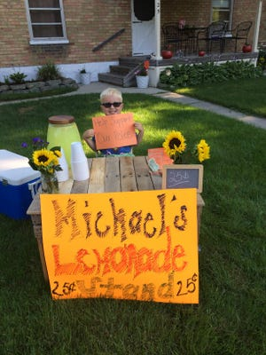 Michael McNabb, 5, of Lexington raises money with his lemonade stand for the Lexington Police Department on Saturday, July 23, 2016/