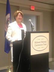 Sen. Amy Klobuchar address the Minnesota delegation