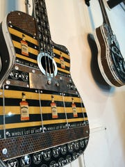 Guitar art by California artist Carol Braden hangs