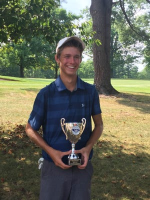 Andrew Forjan holds the winning trophy after capturing the York County Junior Golf Association George Barton Match Play Championship at Hanover Country Club on Tuesday.