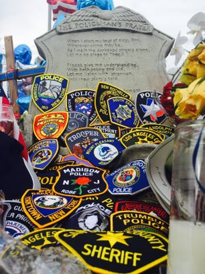 Patches laid at the Baton Rouge funeral for officer Montrell Jackson.