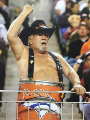 """The late Tim McNernan built a legacy, following and alter ego as """"Barrel Man,"""" at Denver Broncos games for 33 seasons."""