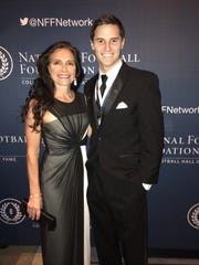 Mike Sadler and his mother, Karen Sadler, attended the National Football Foundation awards dinner together on Dec. 9, 2014, at the Waldorf Astoria in New York City.
