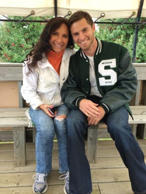 "Former MSU punter Mike Sadler sits with his mother, Karen. Karen called her son her ""best friend."" Mike Sadler died in a car accident last Saturday."
