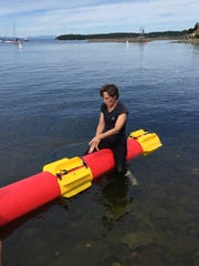 Danielle Rougeau, coach of the Middlebury College log rolling team, demonstrates the sport Sunday at Waterfront Park in Burlington.
