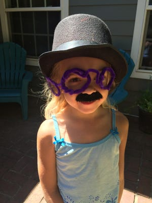 """Addie Hartley aka Lewis McDuck gets on her spy disguise at a """"at-home"""" spy camp."""