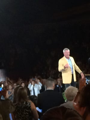 Brett Favre gives the crowd a thumbs up after receiving his Gold Jacket at the Pro Football Hall of Fame's Gold Jacket Dinner in Canton, Ohio.