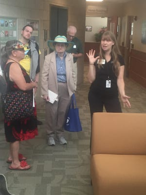 Energy Prize Coordinator Lydia Macklin-Camel (right), here leading visitors on a tour of the energy-efficient Farmington Hills City Hall, said the survey will give community members the chance to help guide the development of the city's solar program.