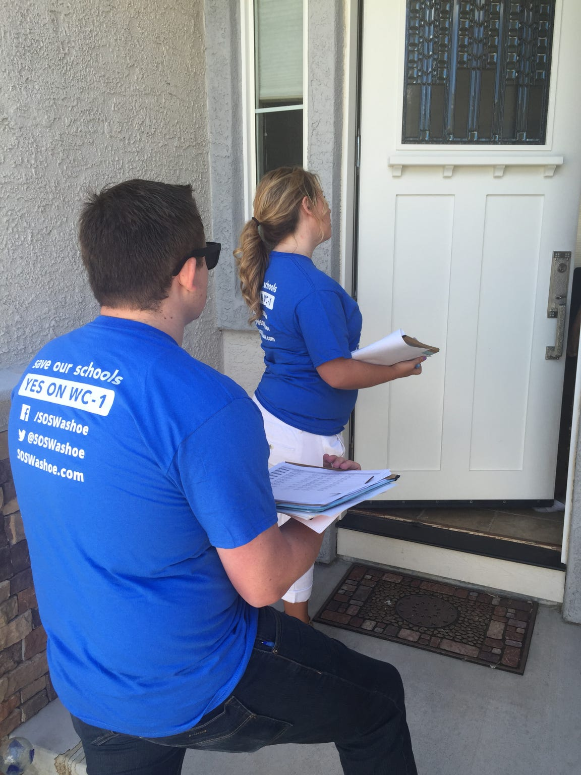 Two volunteers for the Save Our Schools campaign knock