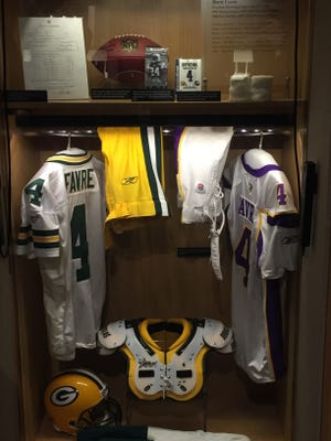 Brett Favre's Hall of Fame display features both a Packers and Vikings jersey