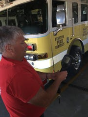 Stayton Fire District Assistant Chief Jay Alley demonstrates one of the department's new, technologically advanced thermal imaging cameras.