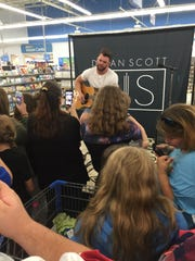 Dylan Scott performs Aug. 15, 2016, at Walmart in West