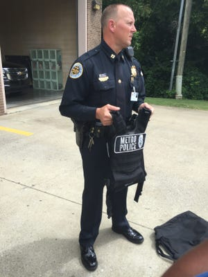 Metro Nashville Police Departmtn Capt. Keith Stephens holds a ballistic plate vest the department currently does not have for officers.  Nashville's police chief and mayor on Tuesday announced a plan to ask Metro Council to approve spending $1 million to purchase the vests and other equipment for officers on Friday.