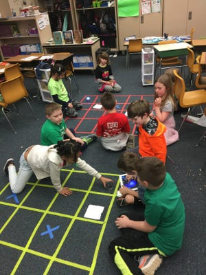 East Washington Academy students work on coding instructions for small robots, called Spheros in March,