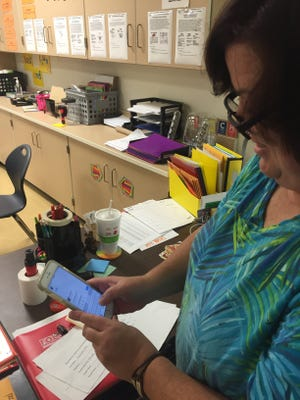 Seventh-grade teacher Janel Wetzel composes a tweet. Northeastern  Middle School has been recognized by Indiana for its use of Twitter to connect the school with families and the community.