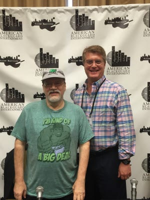 Killer Nashville Writers' Conference founder Clay Stafford, right, poses with best-selling author Robert Randisi at the crime writers' conference, held at the Cool Springs Embassy Suites hotel from Aug. 18-21.