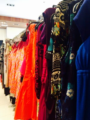 Dresses of all shapes, sizes and colors occupy the Love that Dress! boutique in Coconut Point Mall, which is one of this year's event sponsors. Volunteers spent days preparing the dresses for the main event Sept. 1.