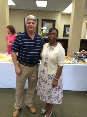 Mary Ball recently retired from BancorpSouth after 42 years. She is pictured with Dan Jones from BancorpSouth.