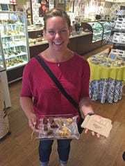 Capital City Food Tours guide Brittany Hammer shows