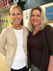 P.D. Graham Principal Jennifer Curry (left) and fourth-grade teacher Amy Griffith are eager for the bell to ring the first day of school.