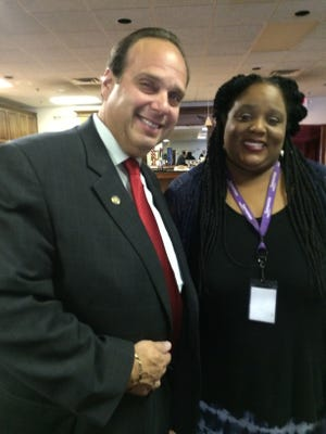 Tania James of Samaritas visits with Don Oesterwind Jr., president of the Westland Rotary Club.