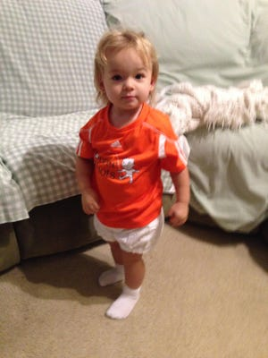 Isabella strikes a pose in her new soccer jersey prior to her practice on Tuesday.
