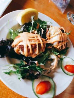 The Signature Crab Cake Appetizer features Asian-scented aioli.