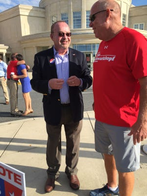 Sussex Democratic Committee Chairman Mitch Crane (left) and House Speaker Pete Schwartzkopf catch up at Cape Henlopen High School on Election Day Tuesday. Turnout was light in the morning hours.