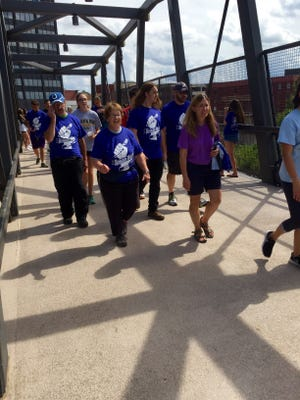 Kay Clemme leads 15 of her relatives in Hunger Hike.