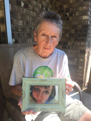 Nikki Brueger holds a photo of her daughter, Ally Brueger, who was shot to death July 30 in Rose Township.