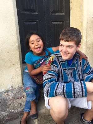 Sten Kordon (right) during a Shepherd of the Bay Lutheran Church mission trip to Guatemala in March. He took the photo with the little girl, Maria, in Chichicastenango.