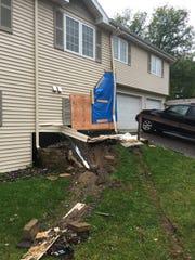 A look at the car crash aftermath at the apartment