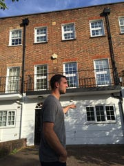 Colts quarterback Andrew Luck walking past the house he and his family lived in off Finchley Road in London.