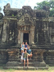 The de Quillacq family outside of a ruin in Cambodia.