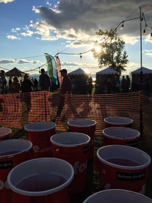 The sun begins to set over the Giant Beer Pong Challenge hosted by Free Press Media at Oktoberfest Vermont 2016.