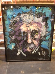 An abstract painting of Albert Einstein graces a doorway in the new STEM Center at Hartnell College.