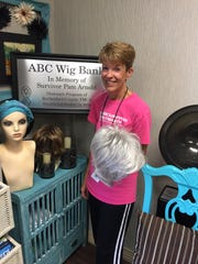 After Breast Cancer leader Melanie Cavender holds a sample from the Wig Bank. The 16-week program offers mental, emotional and physical support for breast cancer patients and survivors.