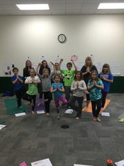 Families can practice yoga together Oct. 15 during the Family Fun Day at the Greenheck Field House.